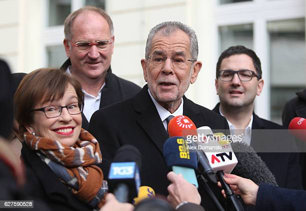 Austrian independent presidential candidate Alexander van der Bellen adresses members of the media in front of a polling station with his wife Doris...