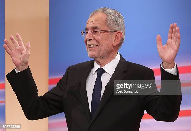 Austrian independent presidential candidate Alexander van der Bellen reacts during a television interview at the Hofburg following Austrian...