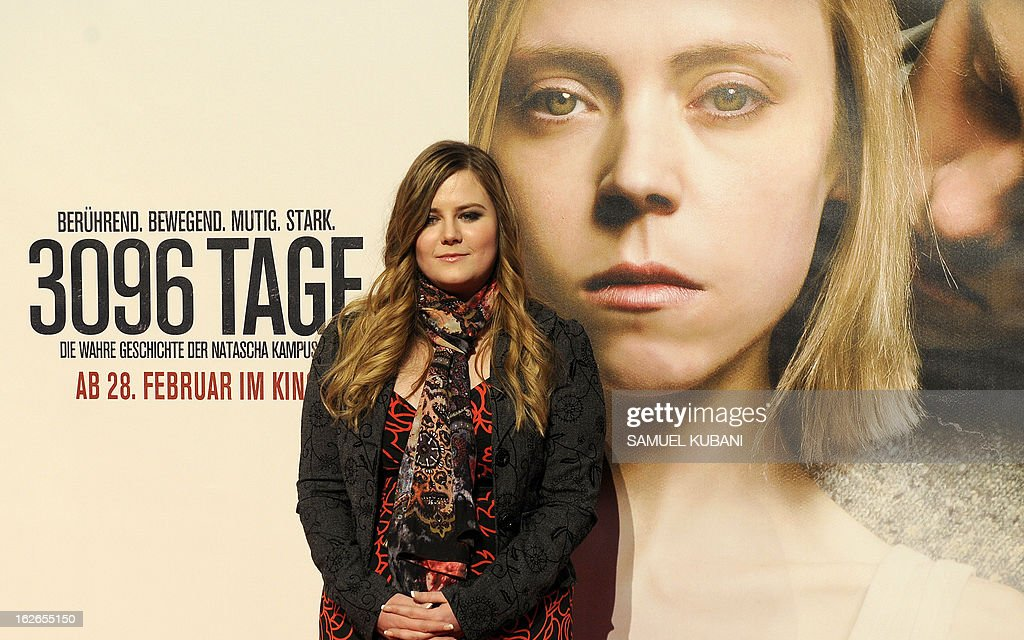 Austrian kidnap victim Natascha Kampusch poses for photographers as she arrives for the premiere of the film '3,096 Days' based on her story on February 25, 2013 in Vienna.