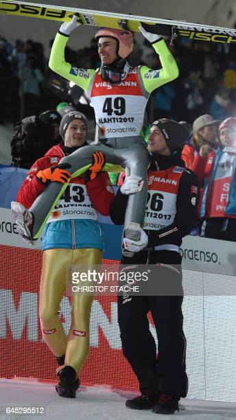Austrian Manuel Fettner Austrian Stefan Kraft and Austrian Gregor Schlierenzauer celebrate after the men normal hill individual event of the 2017 FIS...