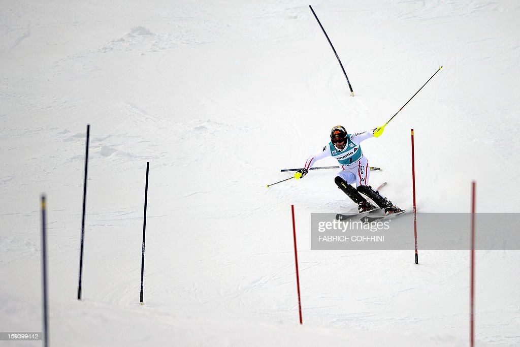 Austrian Mario Matt clears a gate on his way to placed second of the men's giant slalom race of the FIS Alpine Skiing World Cup in on January 13, 2013 Adelboden.
