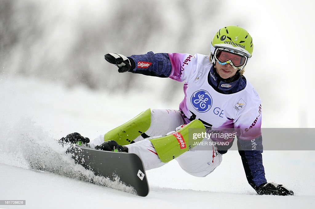 Austrian Marion Kreiner competes to win in a Snowboard Ladies' Paralell Giant Slalom final race during the Snowboarding and Free Style World Cup Test Event at the Snowboard and Free Style Centre in Rosa Khutor near the Russian Black Sea resort of Sochi on February 14, 2013. Austrian Marion Kreinerwon the race ahead of German Ameli Kober and Canadian Ariane Lavigne. AFP PHOTO / JAVIER SORIANO