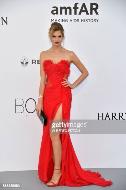 Austrian model Nadine Leopold poses as she arrives for the amfAR's 24th Cinema Against AIDS Gala on May 25 2017 at the Hotel du CapEdenRoc in Cap...