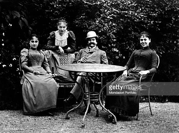 Austrian musician Johann Strauss Jr sitting in the garden of his villa with his family Vienna February 1874