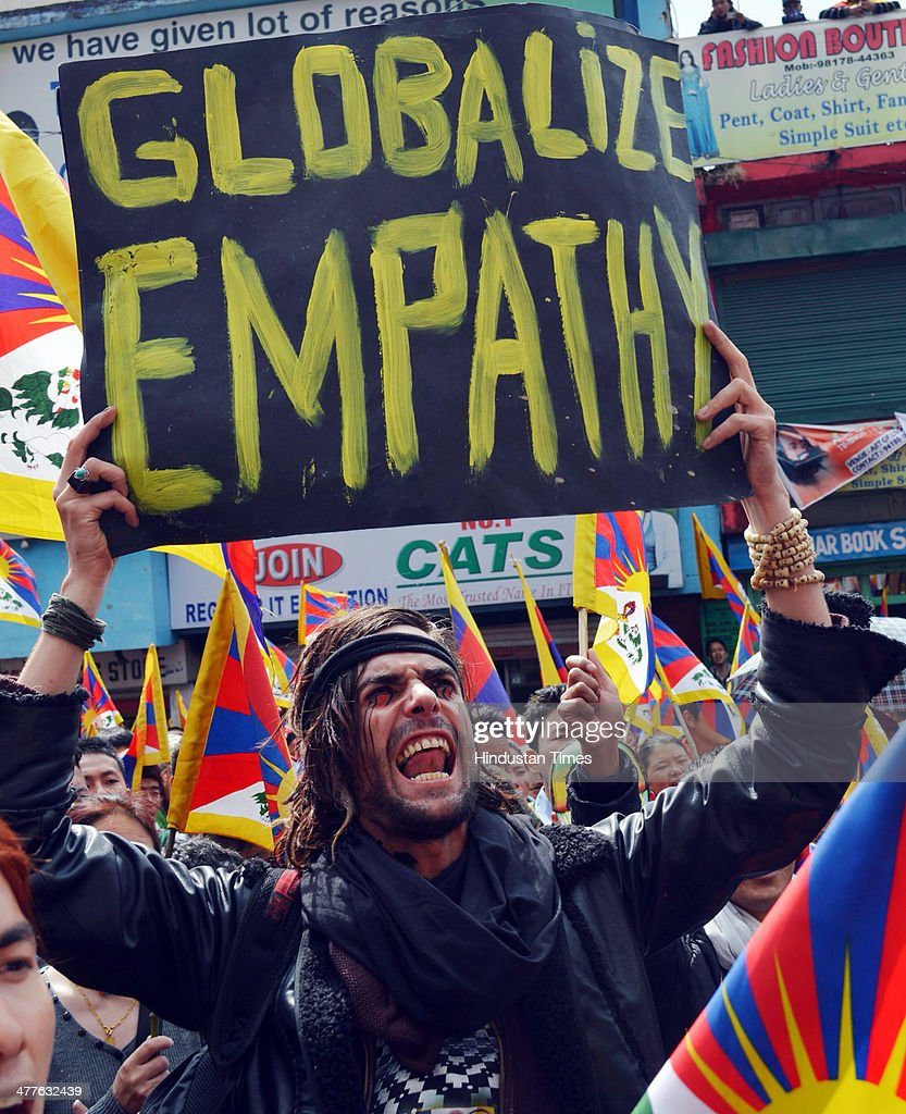 Austrian national Maximilian with a Tibetan flag attached to his hat joins exiled Tibetans at a gathering to mark the 55th anniversary of the failed uprising in the Tibetan capital Lhasa in 1959 on March 10, 2014 in Dharamsala, India. The group demonstrated in support of the 127 people who have self-immolated to protest China's policy towards Tibet and pressed China to allow independent media into Tibet.