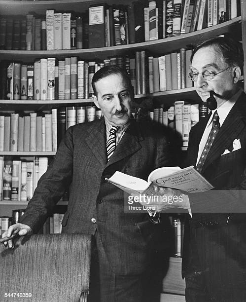 Austrian novelist Stefan Zweig in conversation with his publisher W Huebsch of the Viking Publishing Company circa 1930