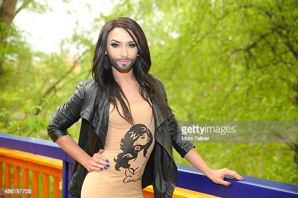 Austrian participant Conchita Wurst poses at the 'Eurovision Song Contest' farewell party on April 22 2014 in Vienna Austria