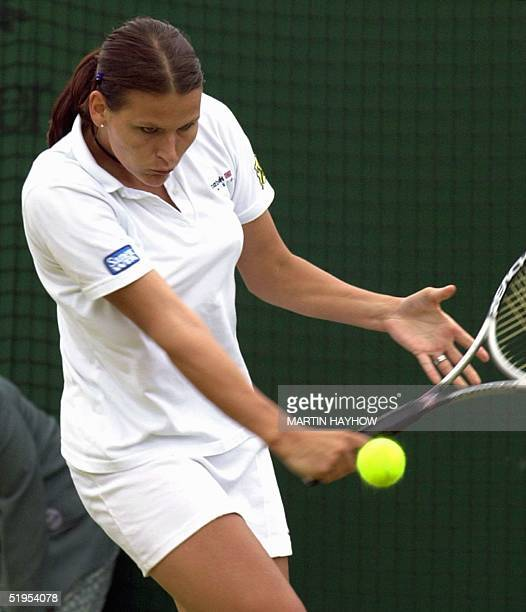 Austrian Patricia Wartusch returns a backhand slice during her third round match of the Wimbledon championships against US Lilia Osterloh 01 July...