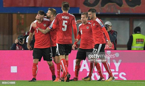 Austrian players celebrate after scoring a second goal during the FIFA World Cup 2018 qualification football match between Austria and Serbia at the...