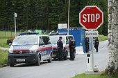 Austrian police maintain a checkpoint on a road leading to the InteralpenHotel Tirol venue of the upcoming Bilderberg conference on June 9 2015 near...