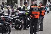 Austrian police officers and motorcycle riders speak at the Harley Davidson Charity Tour 2014 Kick Off at Heldenplatz on August 13 2014 in Vienna...