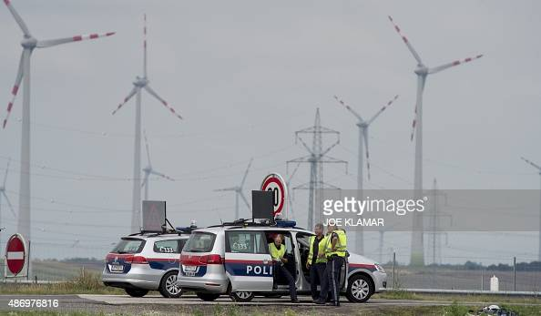 Austrian policemen blockes the motorway A4 near the AustrianHungarian border near Austrian village of Nickelsdorf on September 5 2015 from where...