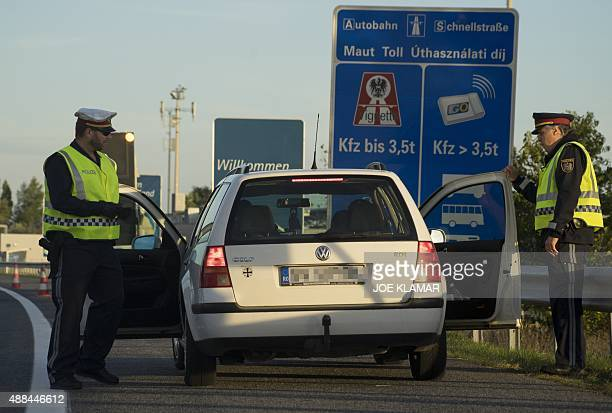 Austrian policemen check a Romanian car during border control at the border crossing between Hungary and Austria at Highway A4 near...