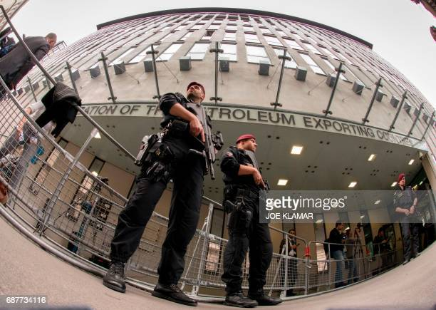 Austrian policemen guard entrance to OPEC headquarters during minister's premeeting in Vienna on May 24 on the eve of the Organization of the...