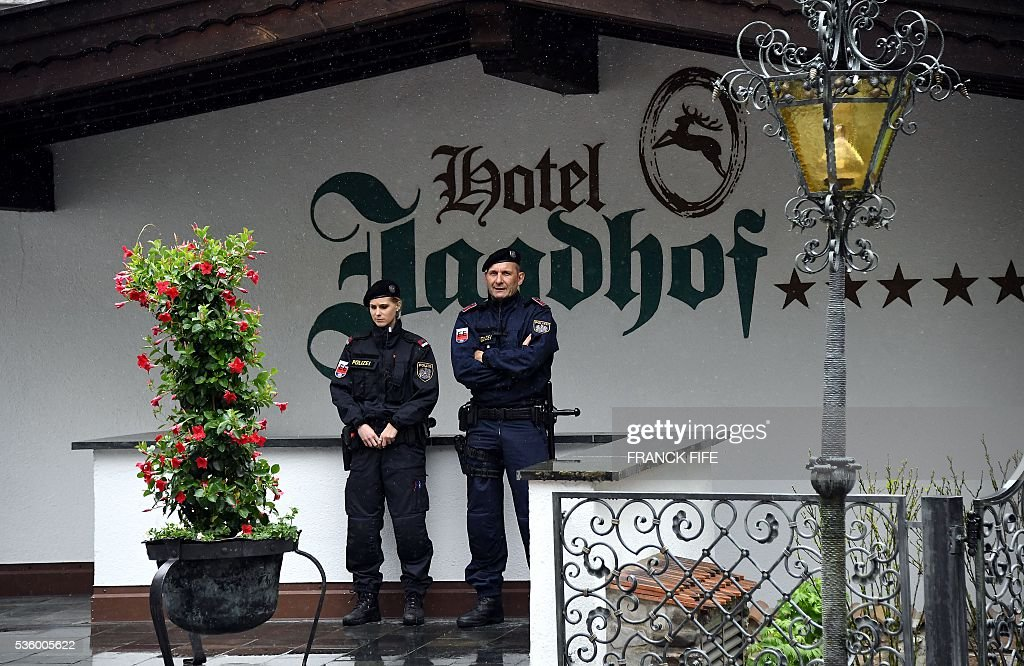 Austrian policemen stand guard on the grounds of the hotel of the French national football team in Neustift im Stubaital near Innsbruck, Austria, on May 31, 2016, where the team stays for a traning camp as part of preparations for the upcoming Euro 2016 European football championships. / AFP / FRANCK