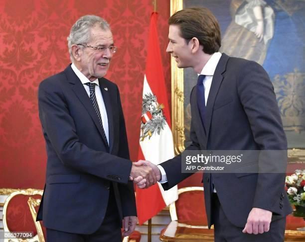 Austrian President Alexander Van der Bellen and Austrian Foregn Minister Sebastian Kurz shake hands during a meeting in Vienna Austria on October 23...