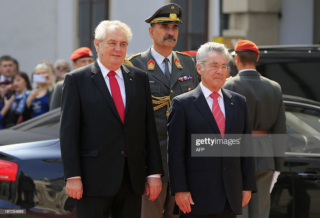 Austrian President Heinz Fischer (R) and Czech President Milos Zeman (L) listen to national anthems, as part of Zeman's visit to Vienna on April 23, 2013.