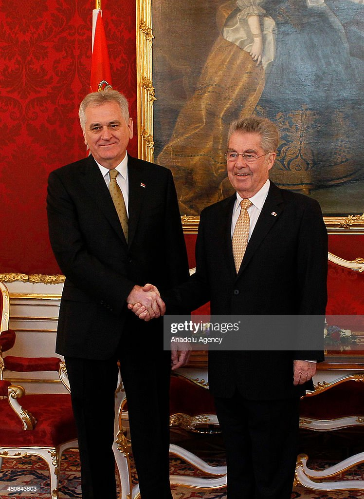 Austrian President Heinz Fischer (R) and President of Serbia Tomislov Nikolic (L) shake hands following their meeting at Hofburg Palace in Vienna, Austria on March 27, 2014.
