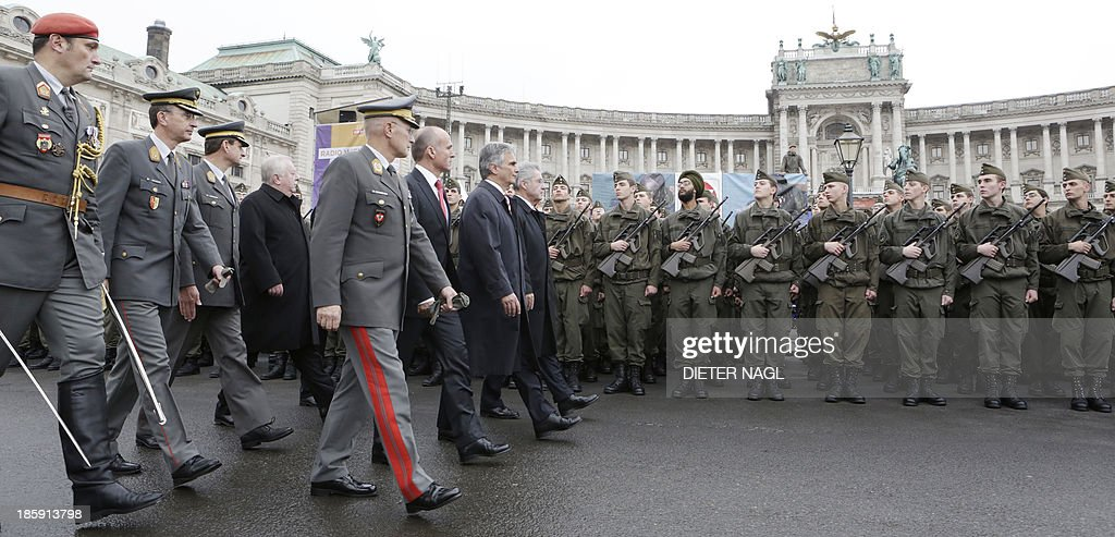 Austrian President Heinz Fischer, Austrian Chancellor Werner Faymann, Austrian Defence Minister Gerhard Klug, Viennas Mayor Michael Haeupl and General Othmar Commenda, Chief of the General Staff review a guard of honor in Vienna on October 26, 2013, the Austrian National holiday. AFP PHOTO/DIETER NAGL