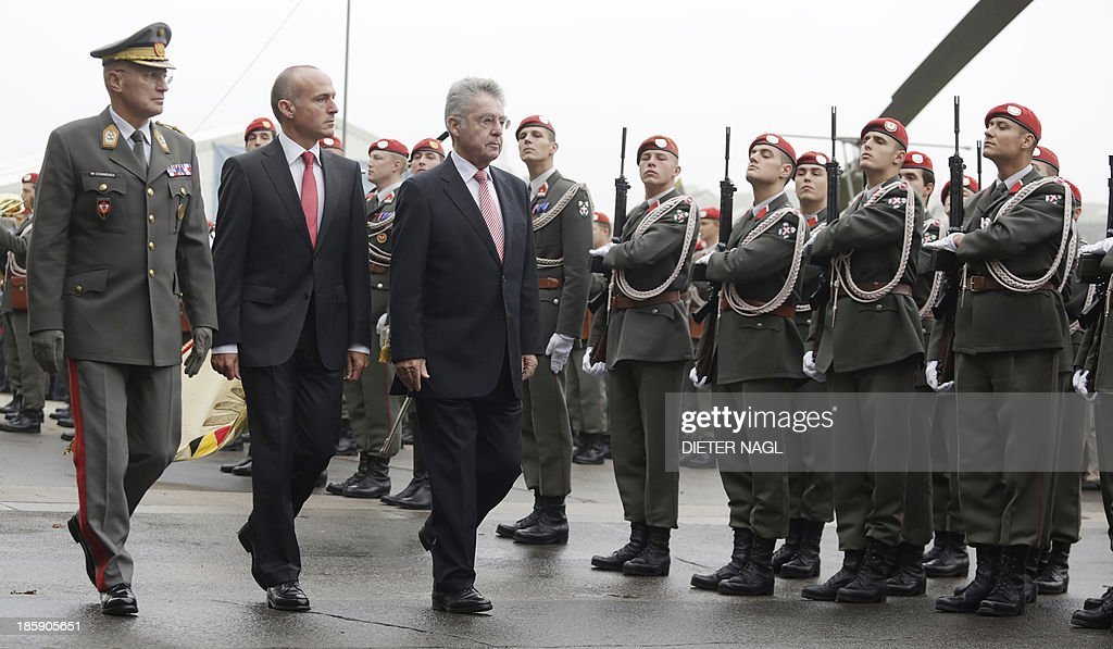 Austrian President Heinz Fischer, Austrian Defence Minister Gerhard Klug and General Othmar Commenda, Chief of the General Staff review a guard of honor in Vienna on October 26, 2013, the Austrian National holiday.