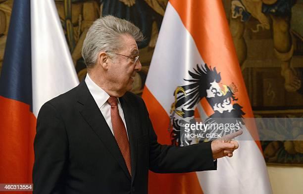 Austrian President Heinz Fischer gestures as walks with Czech Prime Minister Bohuslav to their meeting on December 11 2014 in Prague AFP PHOTO/MICHAL...