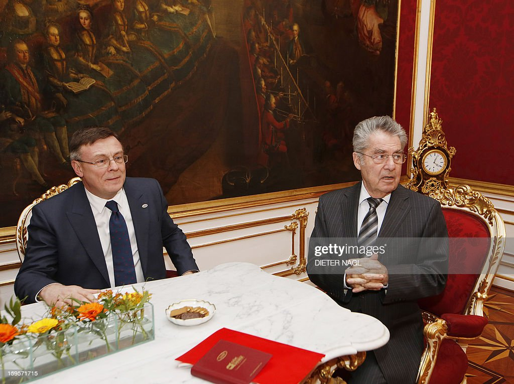 Austrian President Heinz Fischer (R) poses with Ukraine's Foreign Minister and new president of the Organization for Security and Cooperation in Europe (OSZE) Leonid Kozhara as they met on January 16, 2013 in Vienna.
