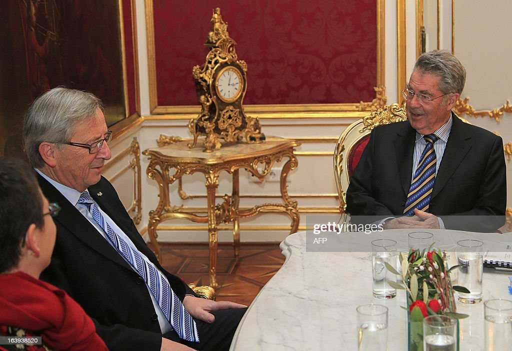 Austrian President Heinz Fischer (R) speaks with Luxembourg's Prime Minister Jean Claude Juncker during a meeting in Vienna on March 18, 2013. Juncker warned that a controversial EU bailout deal for Cyprus could lead to a 'loss of confidence'.