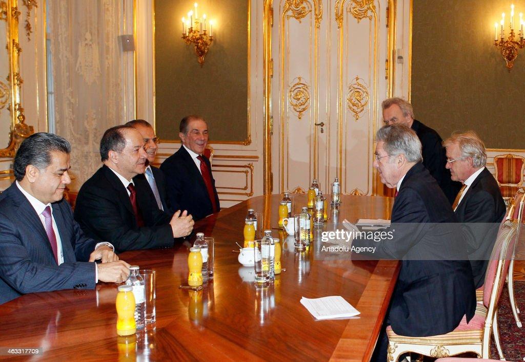 Austrian President Heinz Fischer (R) welcomes Iraqi Kurdistan Regional Government President Masoud Barzani (2ndL) on January 17, 2014 in Vienna, Austria.
