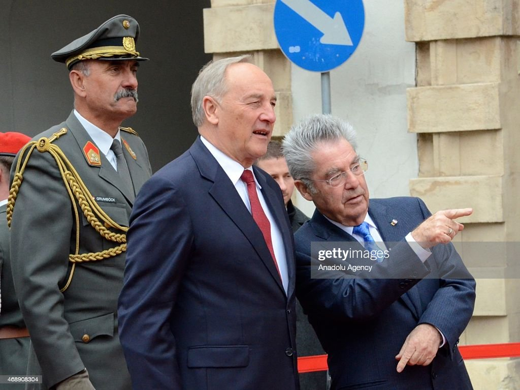 Austrian President <a gi-track='captionPersonalityLinkClicked' href=/galleries/search?phrase=Heinz+Fischer&family=editorial&specificpeople=537198 ng-click='$event.stopPropagation()'>Heinz Fischer</a> (R) welcomes Latvian President Andris Berzins (C) with an official ceremony in Vienna, Austria on April 8, 2015.