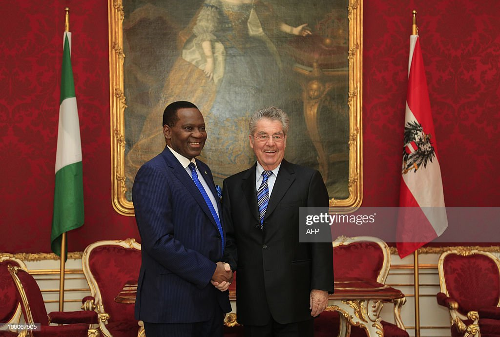 Austrian President Heinz Fischer (R) welcomes Nigeria's Foreign Minister Olugbenga Ashiru (L) as part of his visit in Vienna on April 8, 2013.