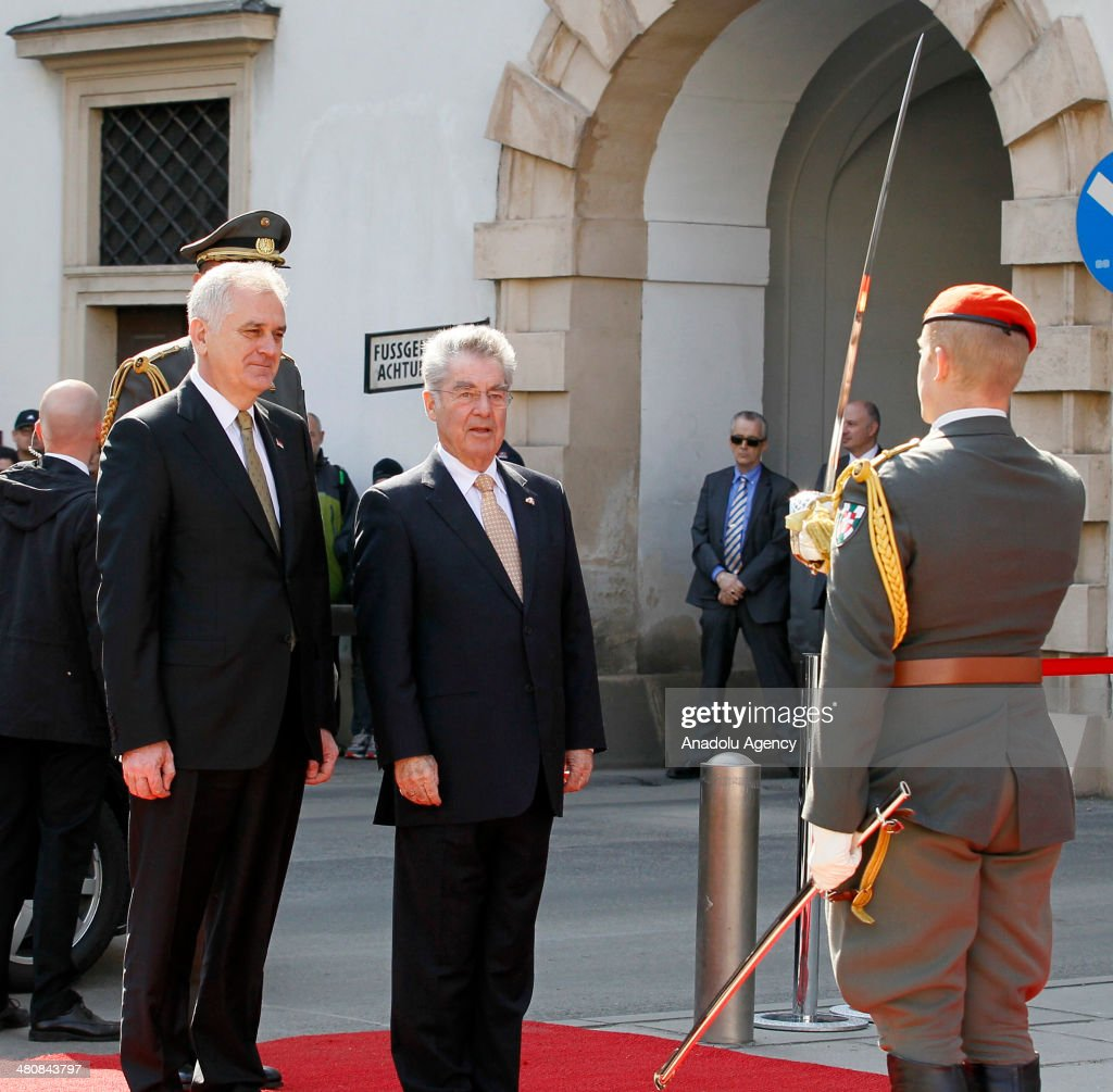 Austrian President Heinz Fischer (R) welcomes President of Serbia Tomislov Nikolic (L) with military ceremony during his official visit to Austria on March 27, 2014.