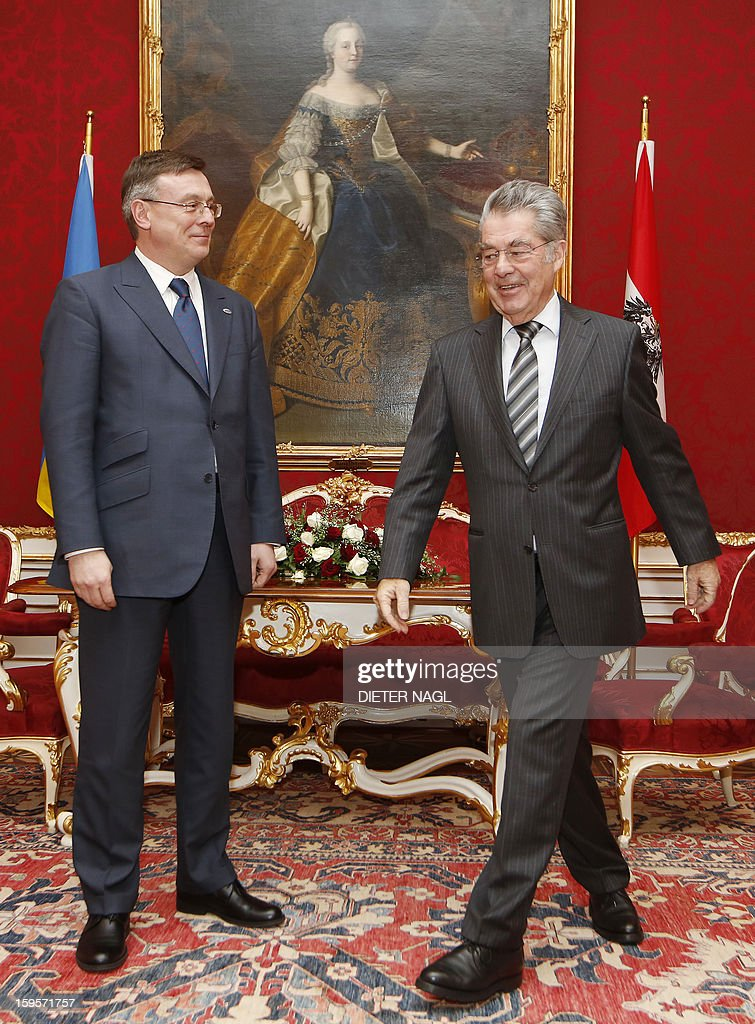 Austrian President Heinz Fischer (R) welcomes Ukraine's Foreign Minister and new president of the Organization for Security and Cooperation in Europe (OSZE) Leonid Kozhara as they met on January 16, 2013 in Vienna, Austria.