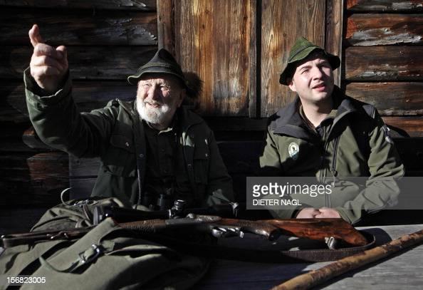Austrian professional hunter and author Willi Neuhauser is pictured with hunter apprentice Viktor Rangger on November 17 2012 at the 'Erzherzog...