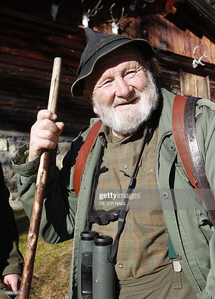Austrian professional hunter and author Willi Neuhauser is pictured on November 17, 2012 at the 'Erzherzog Johann Klause' hunting ground at the 'Brandenberg Valley' in the province of Tyrol, some 340 kilometers west of Vienna. 1928 born Neuhauser who served 40 years of his life as professional hunter at the picturesque landscape of Tyrol is well-known for books, describing his life and work for nature conservation and the passion for mountain hunting.