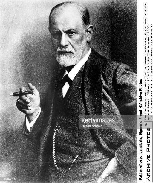Austrian psychoanalyst Sigmund Freud smoking a cigar c 1920