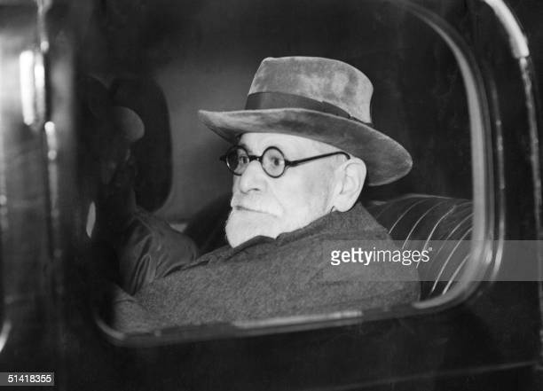 Austrian psychoanlyst Sigmund Freud leaves Victoria Station after his arrival in London 06 June 1938 Freud had his passport restored to him...