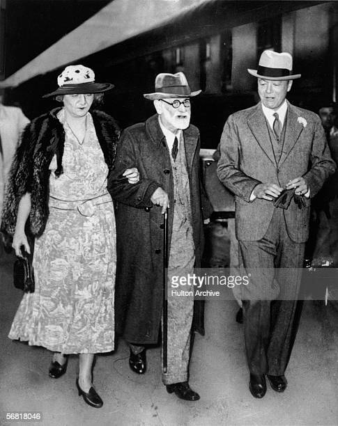 Austrian psychologist Sigmund Freud escorted by Marie Bonaparte a French psychoanalyst and wife of Prince George of Greece and by American ambassador...