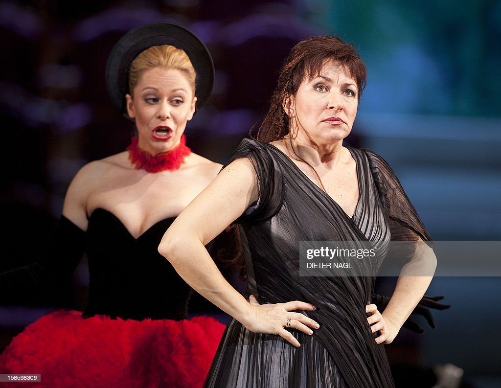 Austrian singer Daniela Fally (L) as Zerbinetta and Bulgarian soprano Krassimira Stoyanova (R) as Ariadne perform at the general rehearsal of a new production of the opera 'Ariadne at Naxos' on December 15, 2012 at the stateopera in Vienna. AFP PHOTO/DIETER NAGL