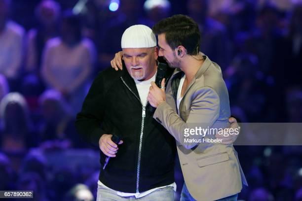 Austrian singer DJ Oetzi and Florian Silbereisen during the show 'Schlagercountdown Das grosse Premierenfest' at EWE Arena on March 25 2017 in...