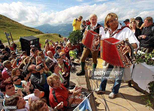 Austrian singer Hansi Hinterseer plays music during his annual walking tour on August 19 2010 in Kitzbuhel Austria