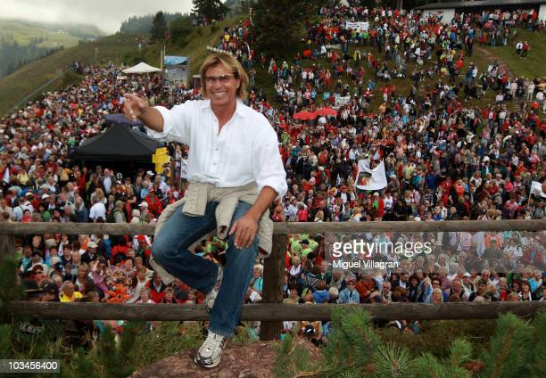 Austrian singer Hansi Hinterseer poses in front of his fans during his annual walking tour on August 19 2010 in Kitzbuhel Austria