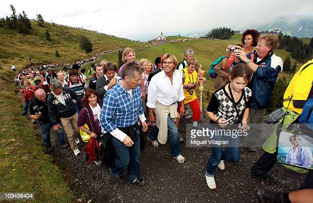 Austrian singer Hansi Hinterseer walks with his fans during his annual walking tour on August 19 2010 in Kitzbuhel Austria