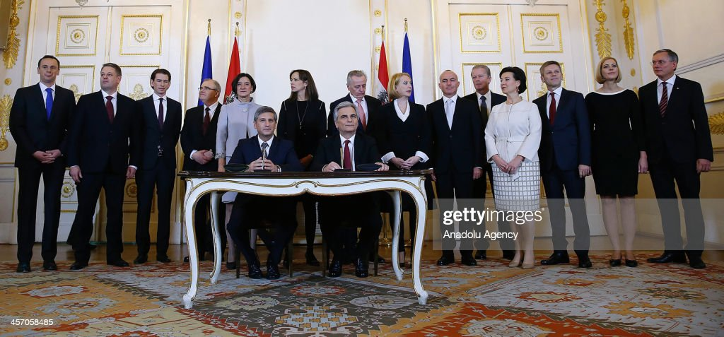 Austrian Social Democratic Party leader and Chancellor Werner Faymann (R) and People's Party leader and Vice Chancellor Michael Spindelegger (L) sign a coalition agreement in Vienna on December 16, 2013.