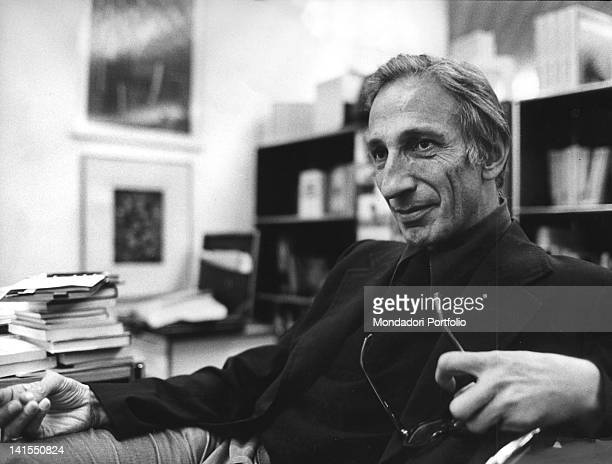 Austrian sociologist and freethinker Ivan Illich sitting with his glasses in his hand 1977