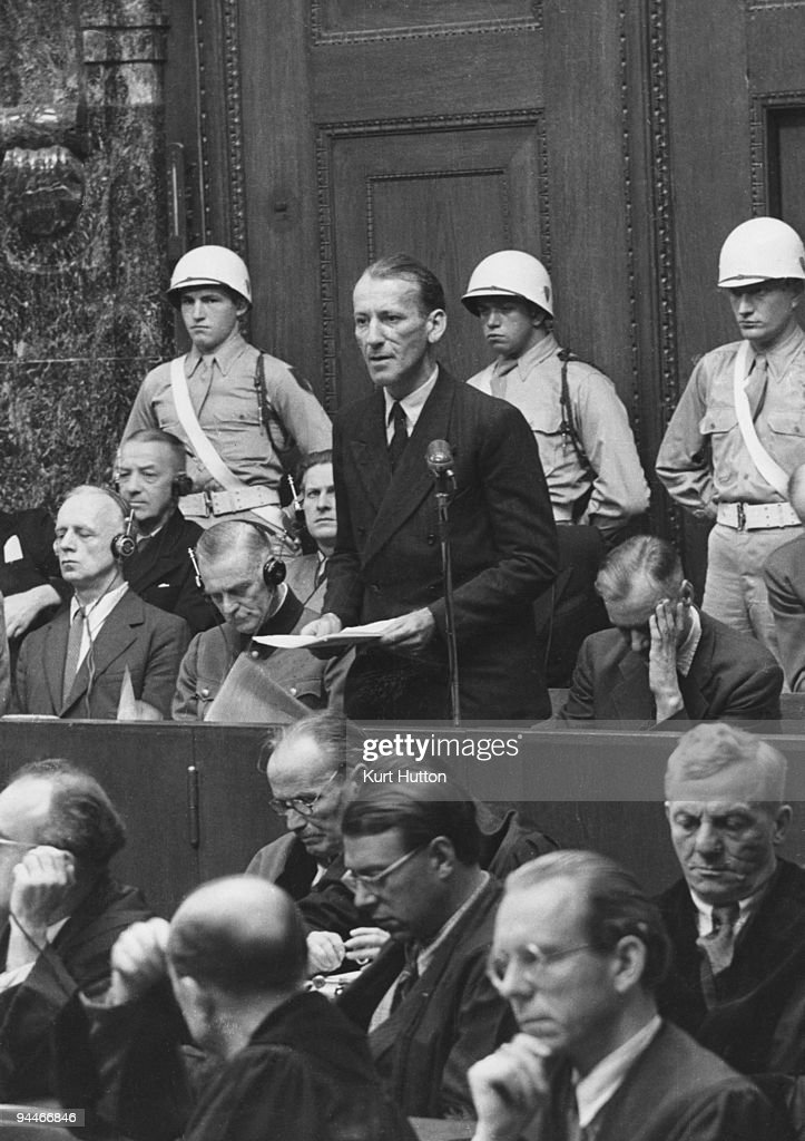 Austrian SS chief Ernst Kaltenbrunner (1903 - 1946) addresses the court during his trial for war crimes at Nuremberg, 1946. He was found guilty and executed on 16th October. From left to right, the defendants are Joachim von Ribbentrop, Erich Raeder, <a gi-track='captionPersonalityLinkClicked' href=/galleries/search?phrase=Wilhelm+Keitel&family=editorial&specificpeople=94240 ng-click='$event.stopPropagation()'>Wilhelm Keitel</a>, Baldur von Schirach, Kaltenbrunner and Alfred Rosenberg. Original Publication : Picture Post - 4200 - The Greatest Trial In History - pub. 21st September 1946