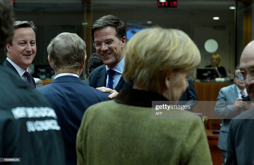 Austrian State Secretary Hans Winkler, British Prime Minister David Cameron, Irish Prime Minister Enda Kenny, Dutch Prime Minister Mark Rutte, German Chancellor Angela Merkel and European Parliament President Martin Schulz chat during a roundtable meeting at the EU Headquarters on February 7, 2013 in Brussels, on the first day of a two-day European Union leaders summit. European Union leaders head into a fresh clash over the EU's budget with the only certainty being that proposals for several years will be cut back.