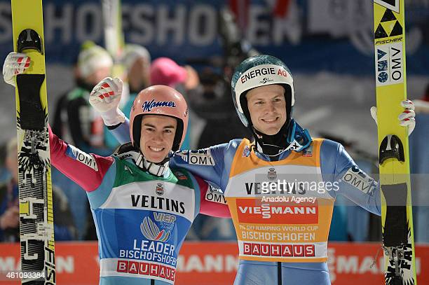 Austrian Stefan Kraft and Michael Hayboeck of Austria celebrate at the final stage of the Four Hills ski jumping Tournament in Bischofshofen Austria...