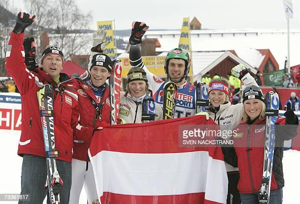 Austrian team Frtiz Strobl Benjamin Raich Marlies Schild Mario Matt Michaela Kirchgasser and Renate Goetschl celebrate after winning the nations team...