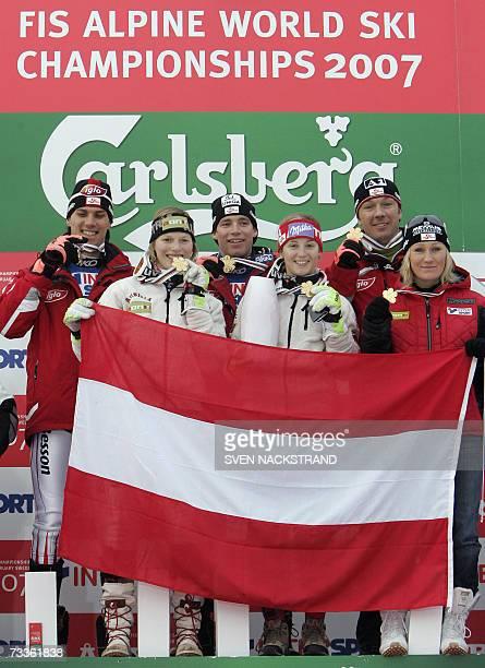 Austrian team Mario Matt Marlies Schild Benjamin Raich Michaela Kirchgasser Frtiz Strobl and Renate Goetschl celebrate after winning the nations team...