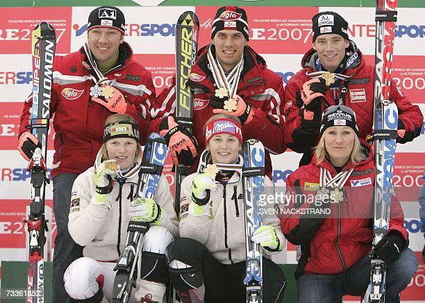Austrian team Mario Matt Marlies Schild Benjamin Raich Michaela Kirchgasser Frtiz Strobl and Renate Goetschl pose after winning the nations team...